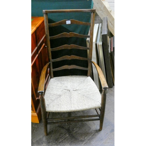 2 - A Lancashire style ladder back elbow chair with rush seat and a similar low seated ladder back chair...