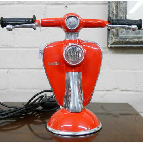 21 - A red decorative scooter shaped electric table lamp...