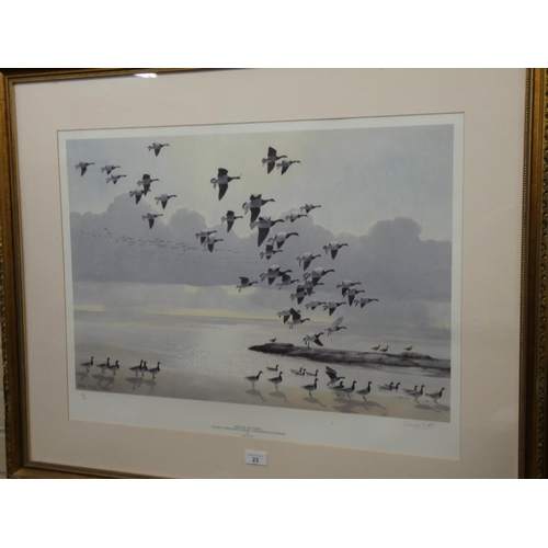 23 - A gilt framed Limited Edition print by Peter Scott of Brent Geese signed by his wife Phillipa Scott,...