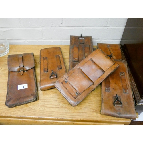 24 - Seven various leather belt fixing document pouches...