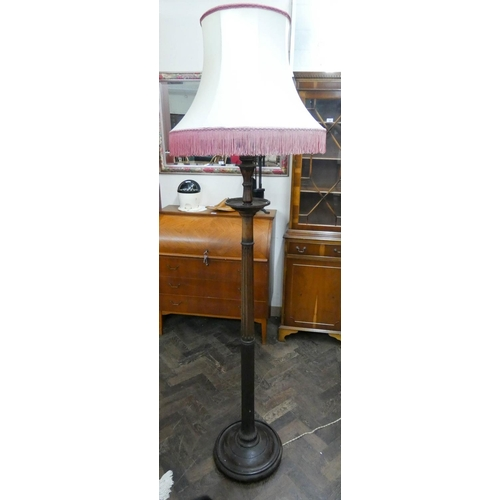 30 - A mahogany reeded column standard lam with shade...