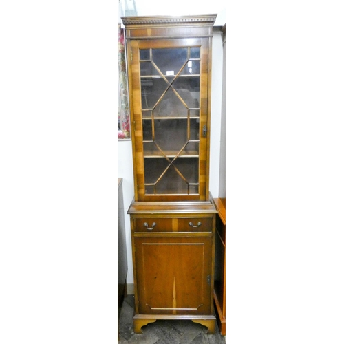 33 - A Georgian style yew wood lattice glazed bookcase with drawer and cupboards under, 21