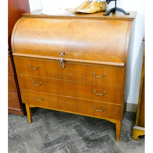 34 - A 1970's teak cylinder top bureau fitted three long drawers, 3' wide...