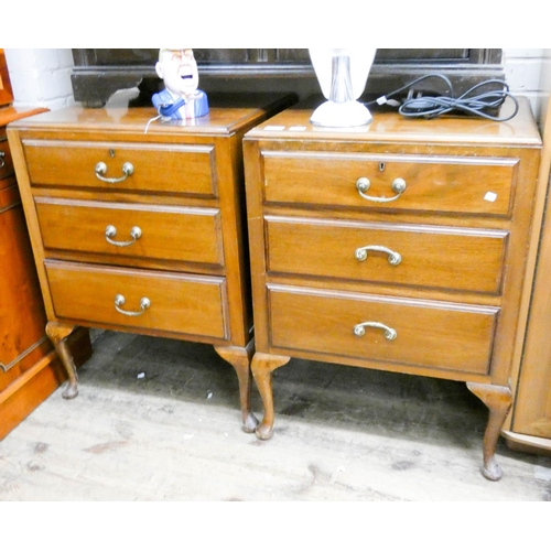 46 - A pair of mahogany chests of three drawers standing on cabriole legs each 23