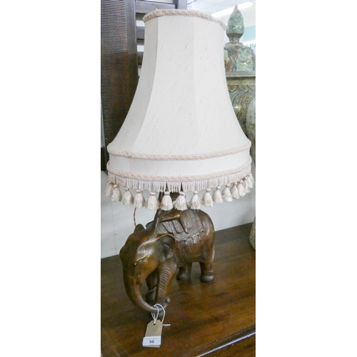 50 - A ceramic elephant table lamp with shade...