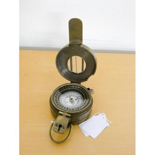 60 - An oxidized brass marching compass...