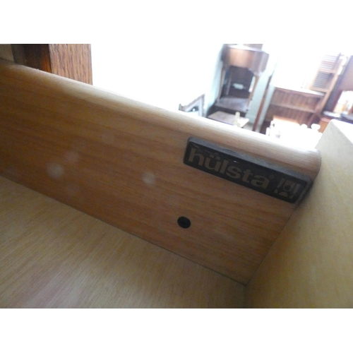 39 - A Hulsta German made oak finished low chest of three long drawers, 3' wide...
