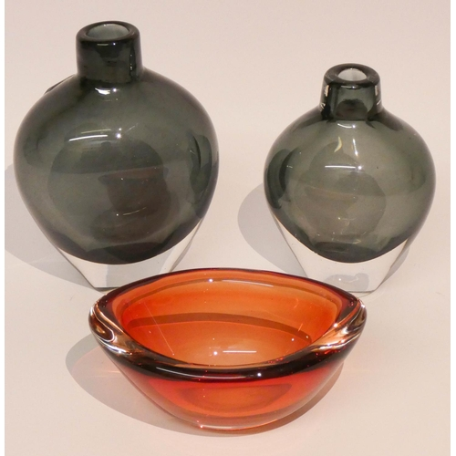 506 - Two heavy Orrefors glass vases and a red Orresfors glass dish...