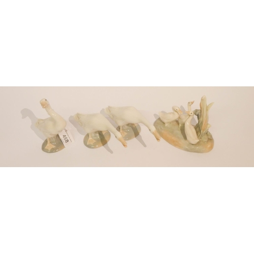 468 - Three Lladro geese ornaments and a Nao duck ornament...