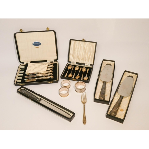 471 - Six silver teaspoons, three serviette rings, six silver handled cake knives, one other and two silve...