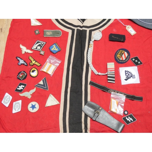 477 - A collection of German war time memorabilia to include, flag, cuff titles, cloth, eagles etc , the f...