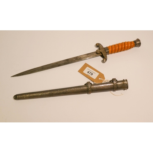 479 - A German copy army dagger in its metal scabbard with plain double edge blade and RZM inscription...