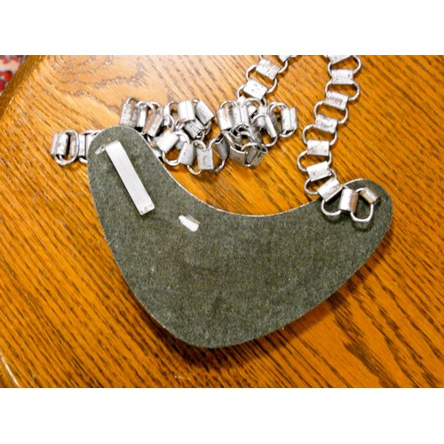 484 - A German Gorget plate and chain together with an old First World War German shell case...