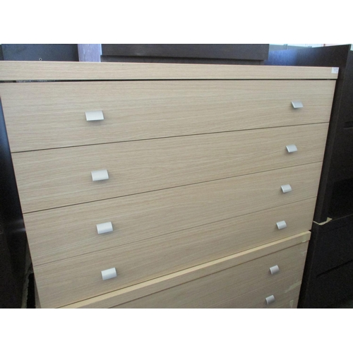 17 - Pair of Modern Light Wood 4 - Drawer Chest of Drawers with Square Metal Handles (2). Nb. Missing Leg...