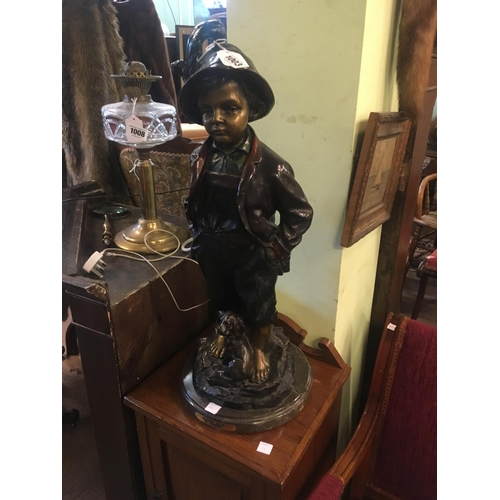 1003 - Bronze figure of young boy on marble base....