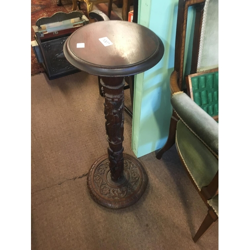 1007 - Carved mahogany plant stand....