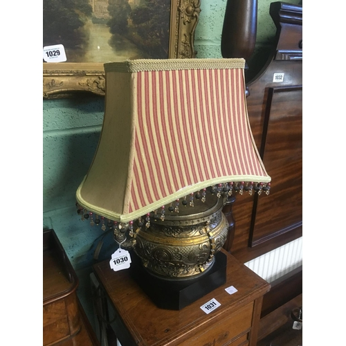 1030 - Ornate gilt and wood table lamp....