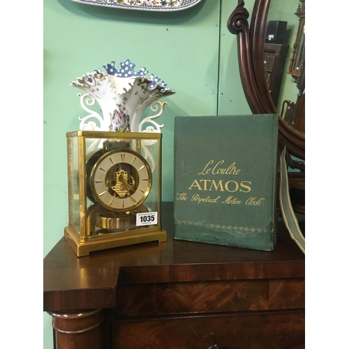 1035 - French Brass Perpetual Motion clock in original box....