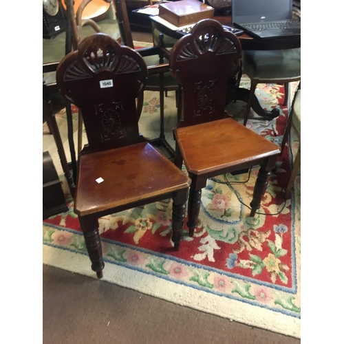 1040 - Pair of Victorian mahogany hall chairs....