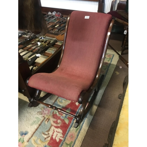 1059 - Victorian upholstered rocking chair....