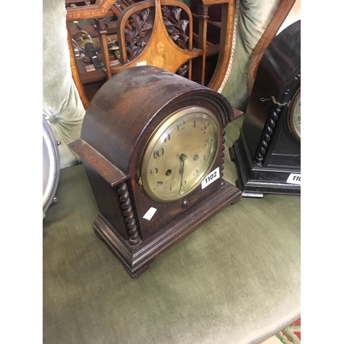 1102 - Edwardian oak mantle clock with silver dial....