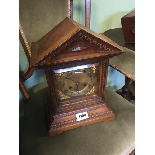 1104 - Late C19th. Walnut mantle clock with brass dial....