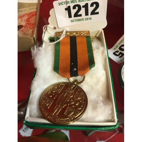 1212 - 1971 Survivor's medal and two other ribbons in original box....