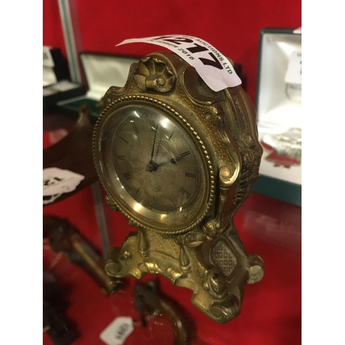 1217 - Small ornamental brass mantle clock....