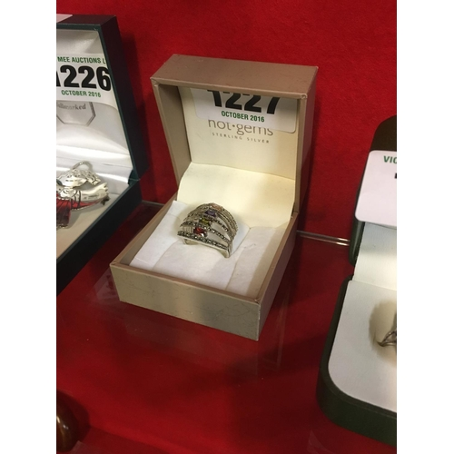 1227 - Four stone silver ring....