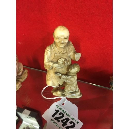 1242 - Netsuke man and boy....