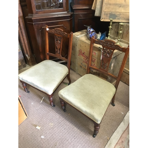 1259 - Pair of Victorian walnut nursing chairs....