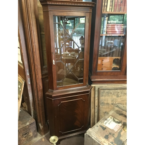 1291 - Victorian mahogany corner cupboard in the Chippendale style....