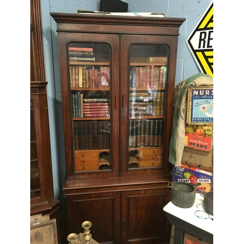 1292 - Victorian mahogany library bookcase with two glazed doors. (books not included)....