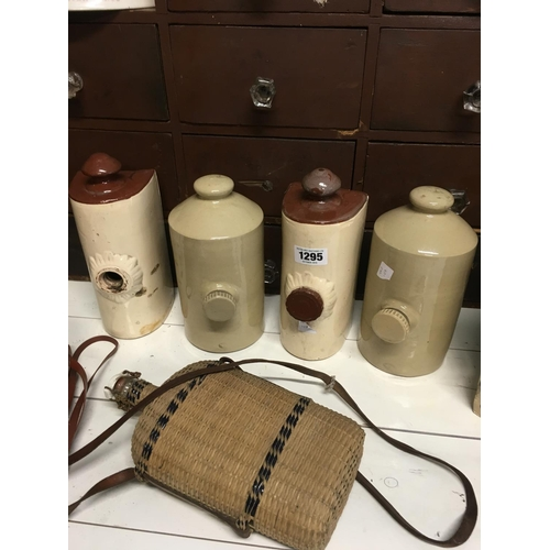 1295 - Four C19th stoneware hot water bottles and holy water bottle....