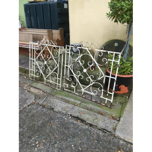 1313 - 1960's wrought iron entrance gates. (212cmL x 102cmH)....