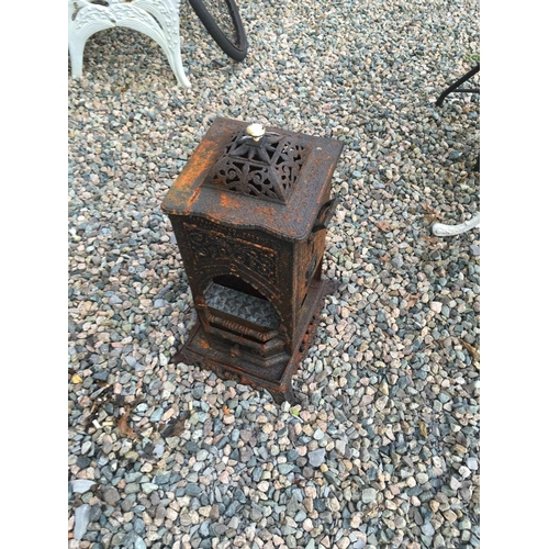 1329 - Cast iron stove....
