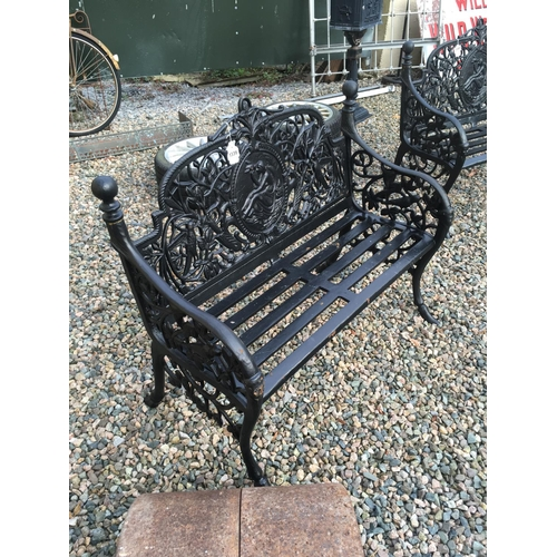 1339 - Decorative cast iron two seater garden bench....