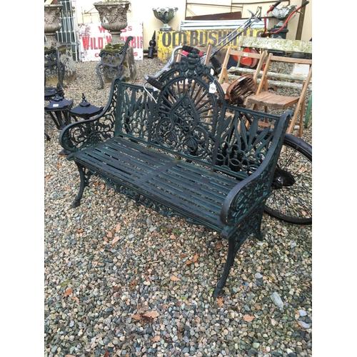 1357 - Decorative cast iron three seater garden bench....