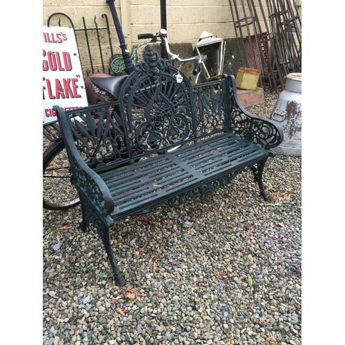 1358 - Decorative cast iron three seater garden bench....