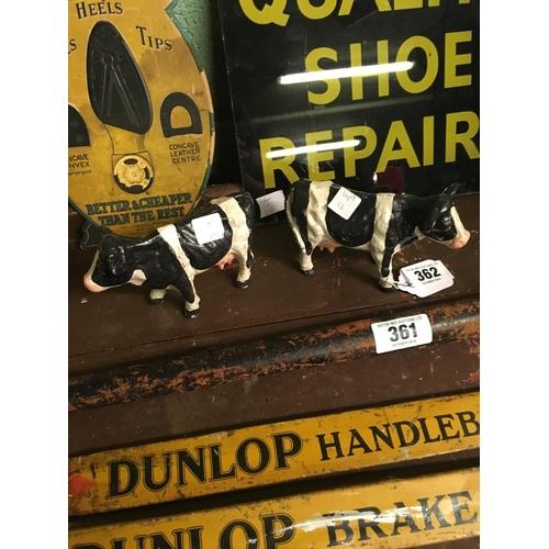 362 - Two cast iron Freisian cows....