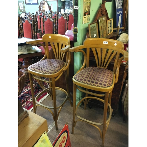 439 - Two high bentwood chairs and a high bentwood stool....