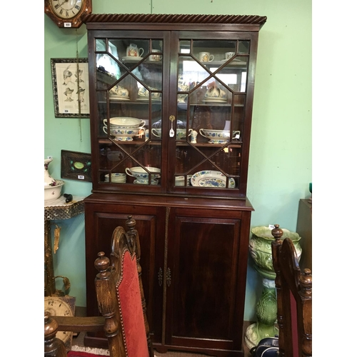 450 - Regency mahogany library bookcase with two glazed doors over two panelled door....