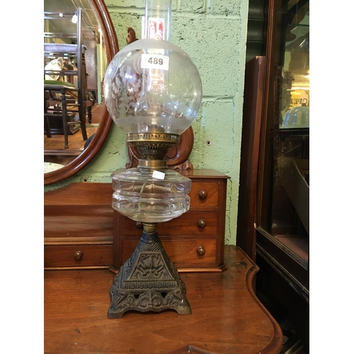 489 - Victorian glass and metal table lamp with original shade....