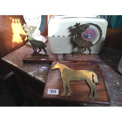 515 - Pair  brass deers mounted on a mahogany plaques and a horse mounted on a wooden plaque....