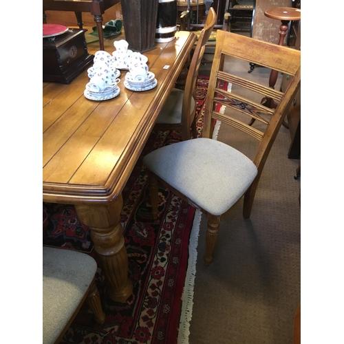 521 - Mahogany kitchen table and six matching kitchen chairs....