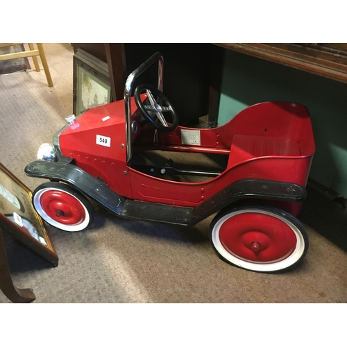 549 - Child's tin plate pedal car....