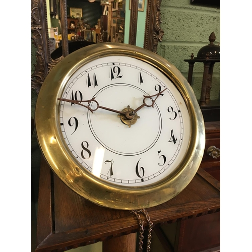 562 - C19th. Brass wall clock with ceramic dial....