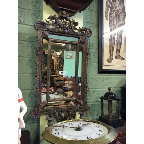 564 - Decorative gilt wall mirror....