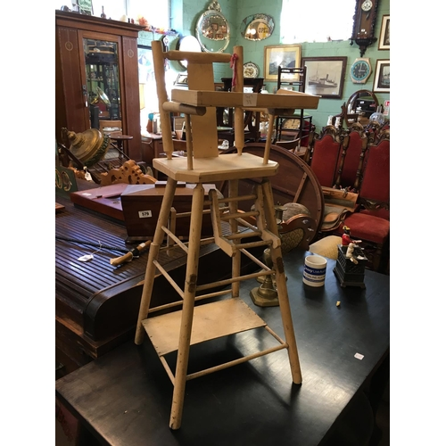 582 - Doll's wooden high chair....