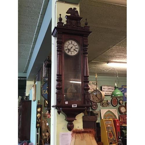 588 - Mahogany spring driven Vienna clock....